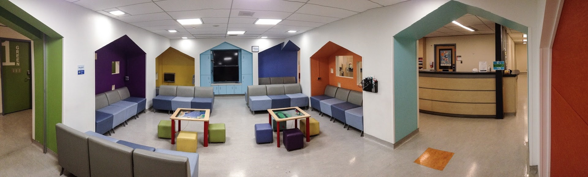 Department waiting room with colourful chairs and tables