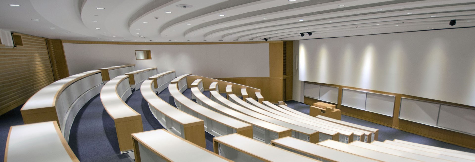 Empty lecture hall of 15 rows and a speaking podium